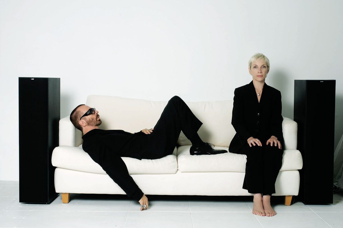Photo Of The Week: Eurythmics – Annie And Dave Pose On The Sofa